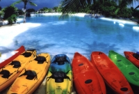 Colorful kayaks by the lagoon.