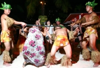 Guests having fun in doing the Limbo Rock at the Hawaiian Luau dinner show.